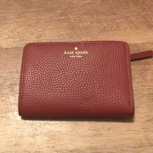 NWT Kate Spade Wallet in color Port Brown
